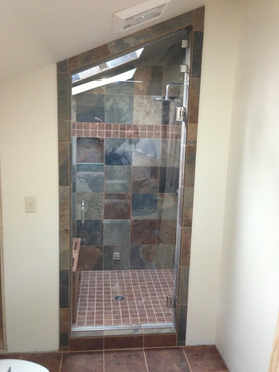 Shower Door with cool granite tiling in the back