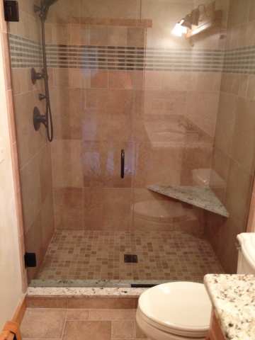 Door and Panel on this walk in shower with corner seat, and oil rubbed bronze hardware