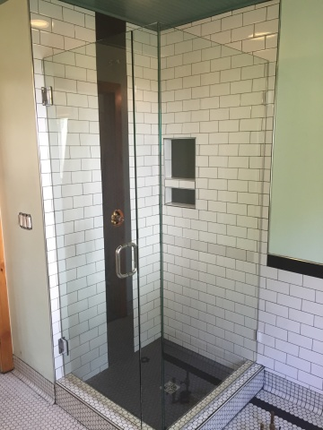 Corner shower with clear glass and chrome hardware