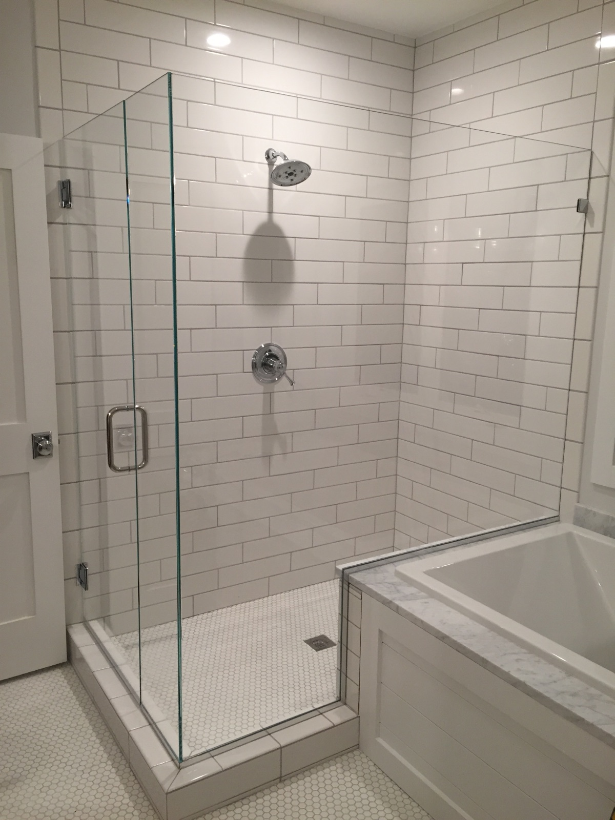 Euro style with Low Iron glass to accent the white tile