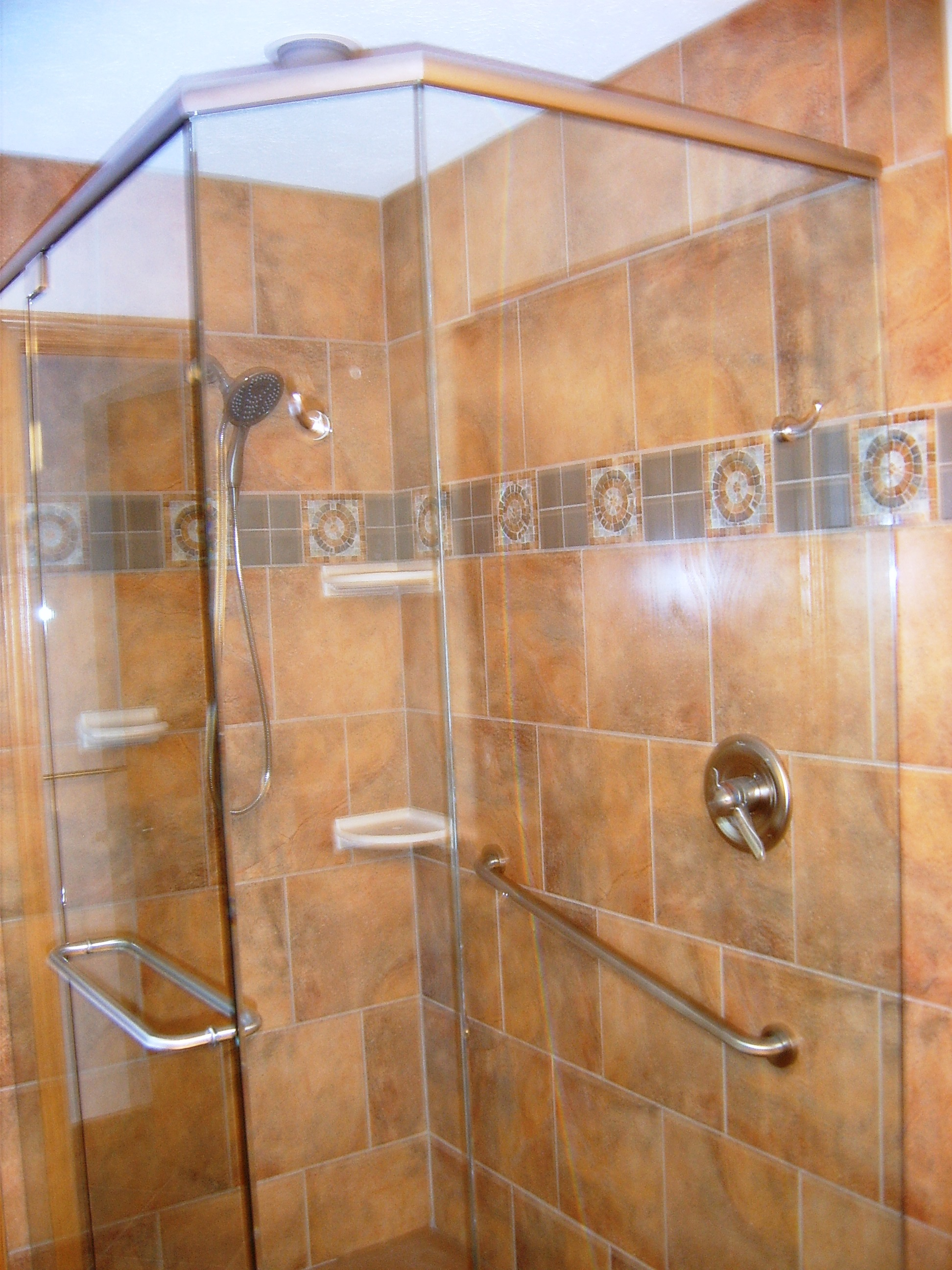 Corner shower with two sided glass wallks
